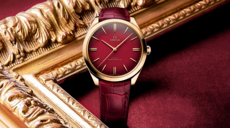 The 18k gold copy watches have red dials.