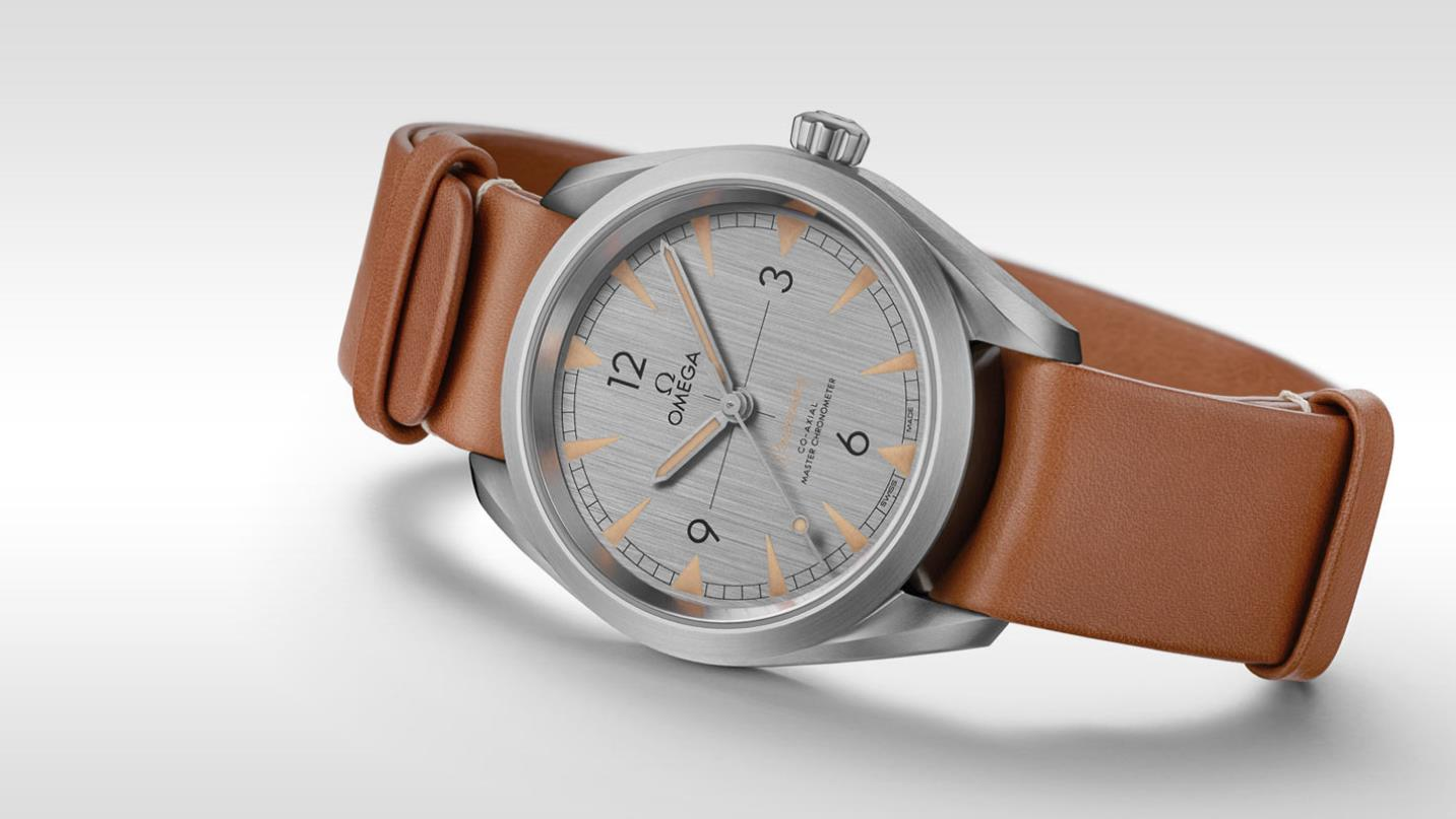 The stainless steel fake watches have brown straps.